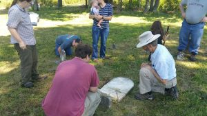 Examining the grave markers of Willie I. Goodnight (1859-1860) and Elizabeth Goodnight Dye (1797-1874)..