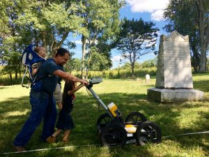 Kentucky Heritage Council Archaeology Review Coordinator, Nick Laracuente, multitasking and assisting with the GPR survey.